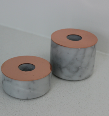 carrara marble and copper candle holders